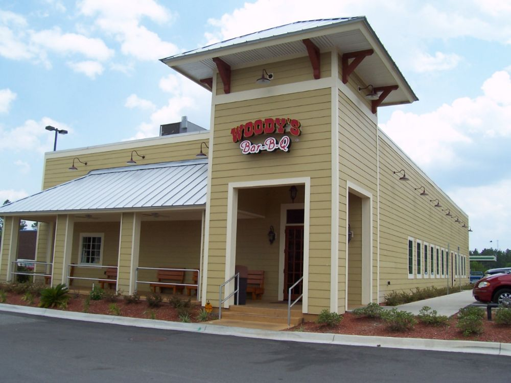 Building exterior of Woody's Bar-B-Q.